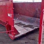 Side photo of red 15 yard dumpster rental with door