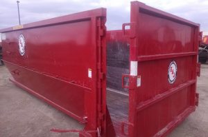 Side image of red 30 yard dumpster with door for rent