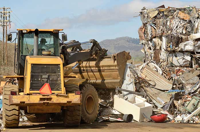 Lift moving waste at landfill
