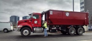 Schaumburg dumpster rental company unloading roll-off container
