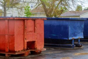 blue and red 20 yard dumpsters placed in a residential area